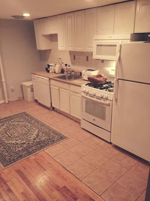 Common area includes a kitchen with full use of flatware, plates, pots/pans, coffee maker and juicer to make healthy, homemade meals when you prefer to stay in