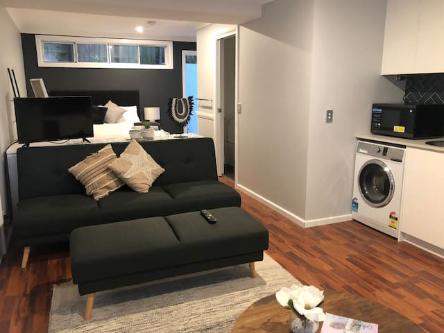 An open plan studio, where the bedroom flows into the lounge area. The TV can turn to face either the lounge room or bed.