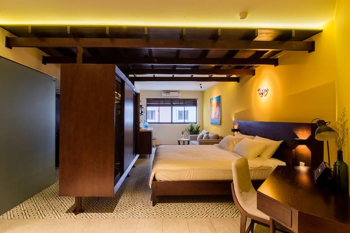 Our tropical studio is inspired by the famous yellow houses of Hoi An