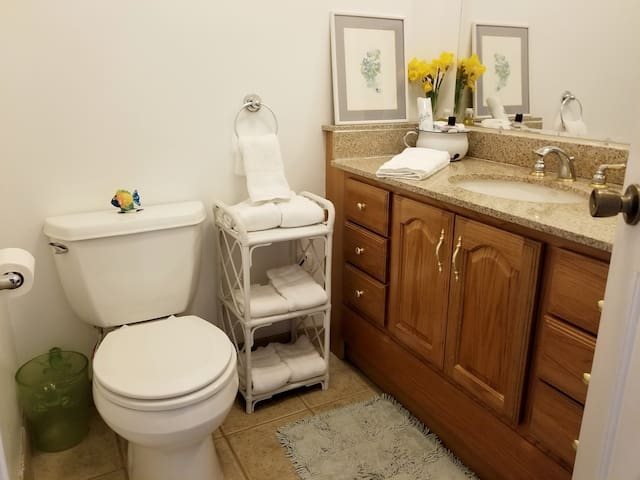 You will have a private bath with showerand a shared half bath.