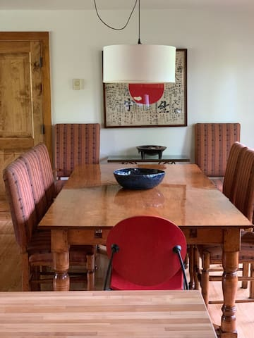 Dining table has two leaves and can seat up to 10.