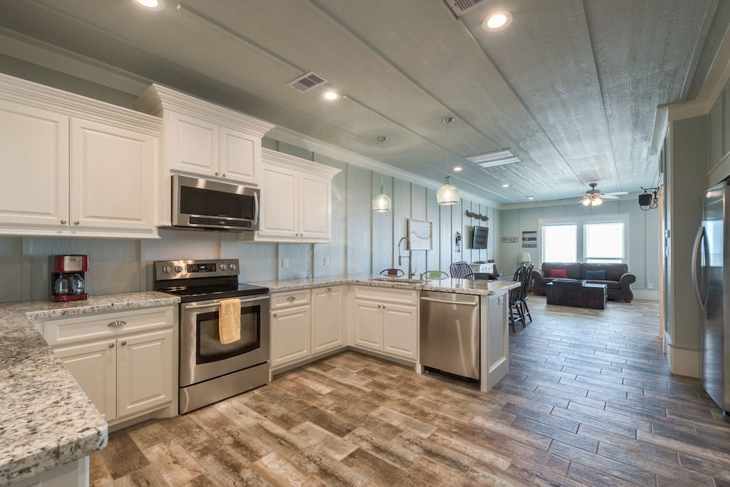 Large kitchen with eat up bar.  Stainless steel appliances and fully equipped for cooking and dining