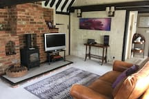 Living room with wood burning stove and TV