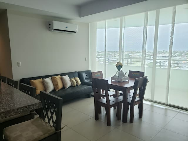 Elegant room with large balcony overlooking the city and Mar Bravo.