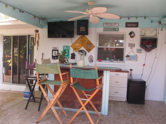 Key West style home with back bar and pool