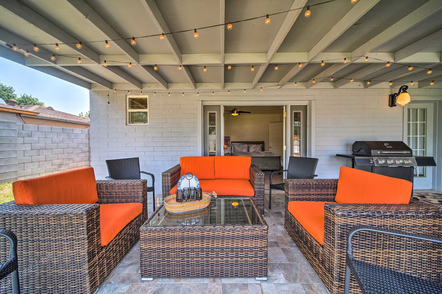 This 4-bed, 3-bath house features a spacious, stylish patio for 8 to lounge!