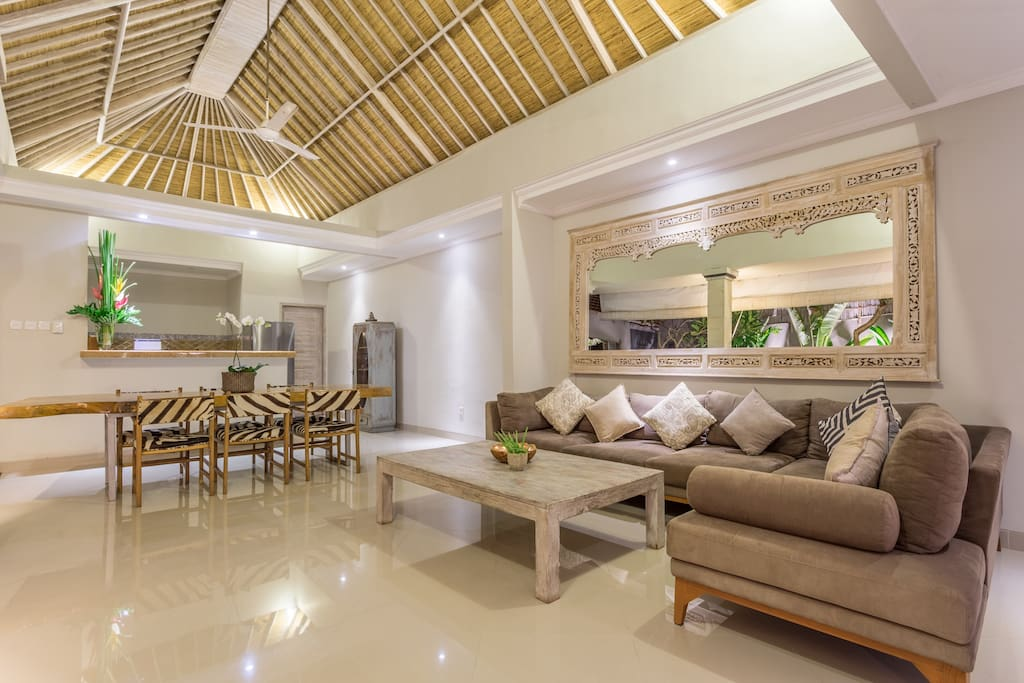 The luxurious open style living, dining and kitchen area overlooks the exquisite pool & lush gardens. The traditional hand woven  rattan/bamboo high ceiling and carved Balinese whitewash mirror creates a grand feeling with extra light and airflow.