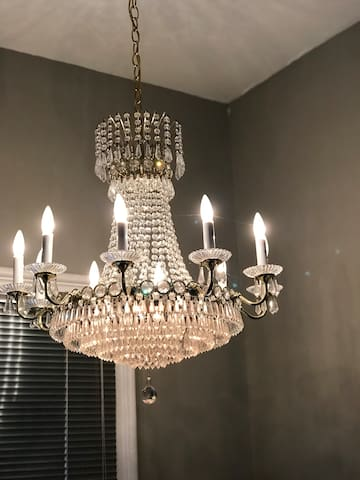 Chandelier above the stairs as you walk up to the second floor apartment