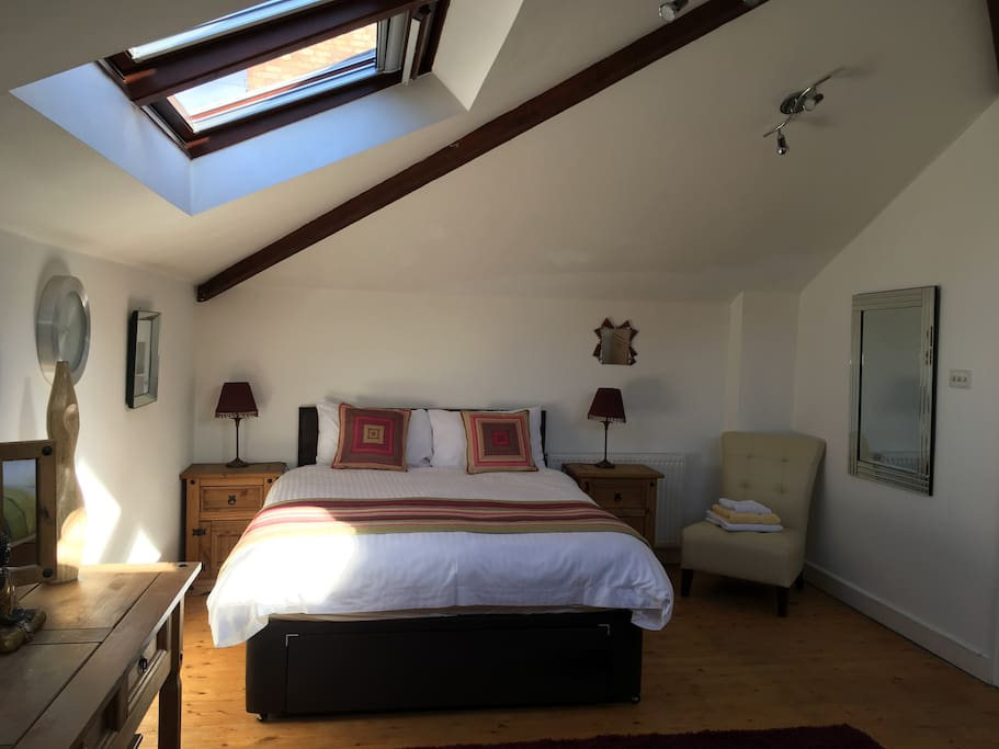 King size bed in a very spacious room
