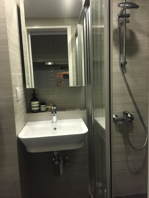 Modern, clean and spacious bathroom, with full sized shower.