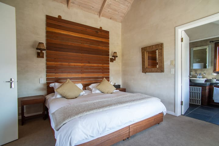 Beautiful bedroom with en suite, and a view of the Atlantic horizon