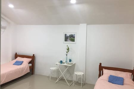 Room 3 - Travelers' Guesthouse Bed & Laundry Shop