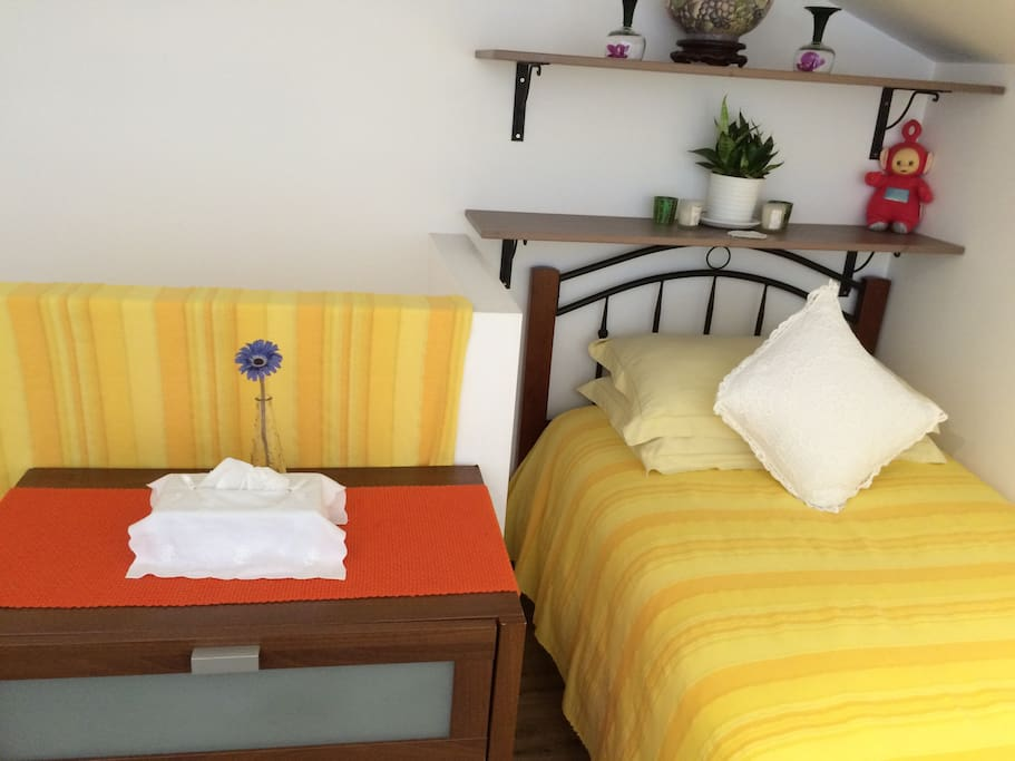 Single bed and the chest of drawers