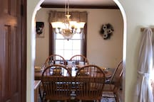 Beautiful curved arch from the living room into the dining room