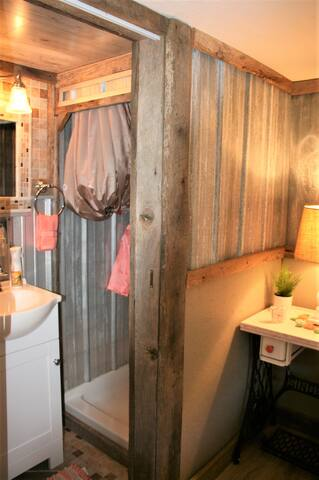 Like the idea of camping but not some of the realities??  Us, too.  We don't like hiking to the bathroom in the night.   No more paying for showers at a crowded RV site.  All the nice fixtures and conveniences of home, new, made to look rustic.