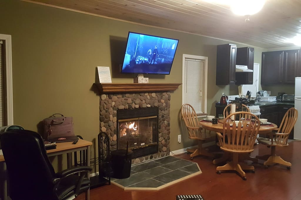 Welcoming Fireplace and 49 inch TV