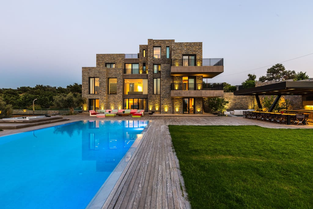 Perched on a 4,000 sq. m private hill overlooking the Cretan sea