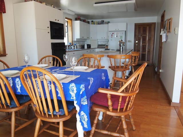 Dining area and kitchen with fridge, microwave, stove top and oven