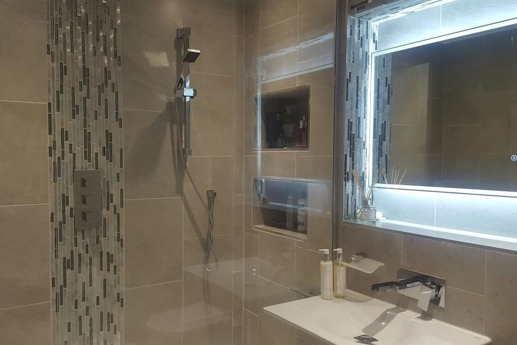 Bathroom with walk-in rainfall and hand shower. Heated Mirror (no steaming up) with Bluetooth so you can listen to music whilst you wash!