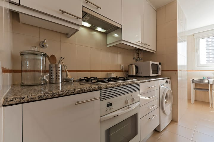 Kitchen with Dryer, Oven, Microwave and Kettle