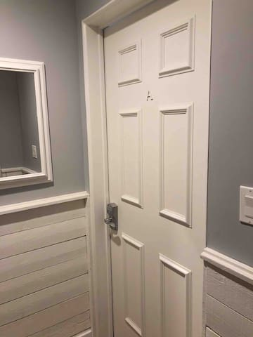 The room prior to entering your unit. There are two locked doors with keypad locks between the main hallway and the unit itself. There is another locked door at the front entrance of the building.