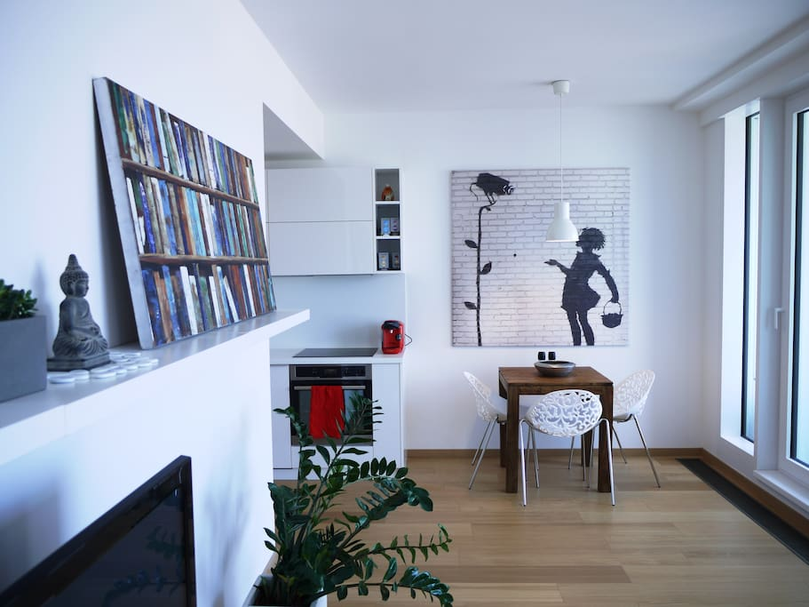 Living room area is brightened with art pieces