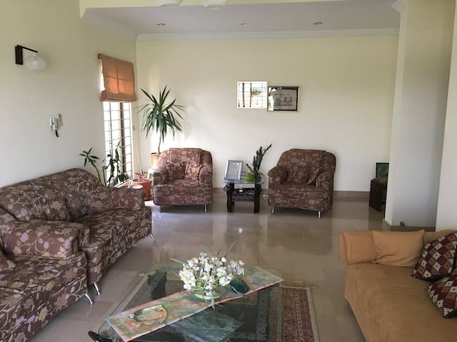 Formal living room can sit up to 10 people