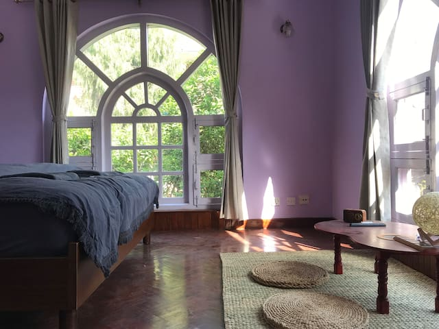 Sunny garden view room in charming villa