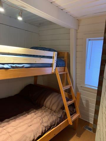 Main floor bedroom, twin over full bunk bed.