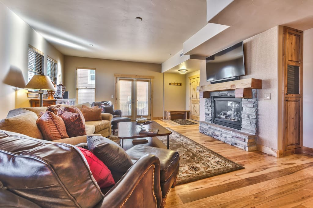 """Entry into Living Room with Mountain Furnishings, Gas Fireplace, 60"""" Samsung Smart TV and Sonos Soundbar with Beautiful Hardwood Floors"""