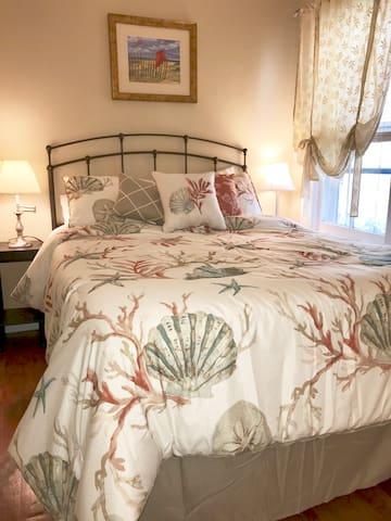 Main floor cozy queen bedroom with attached half bath.