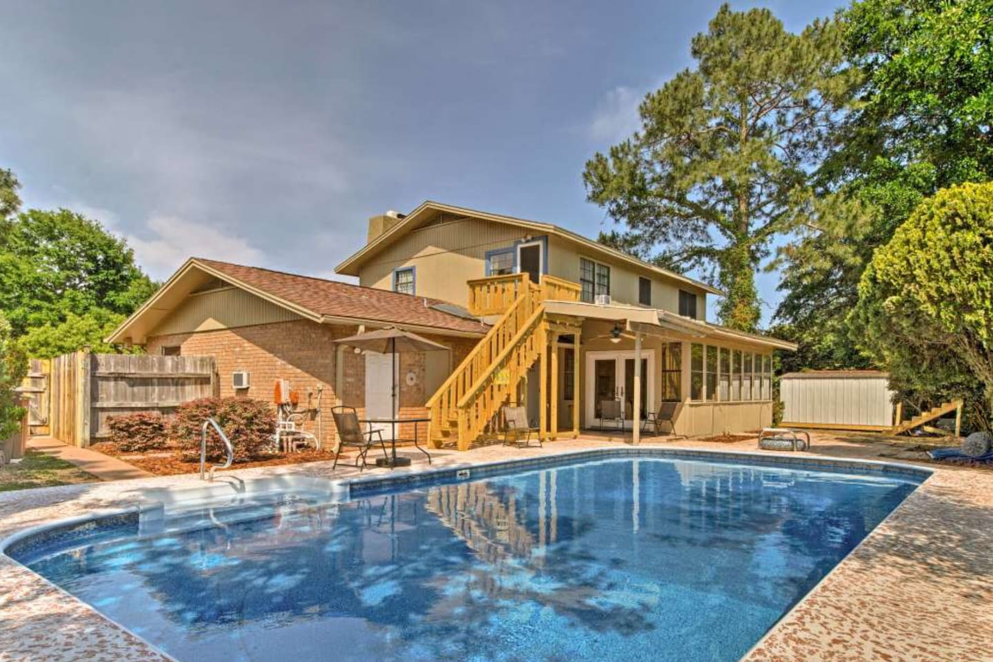 Gorgeous, extremely large 18' X 36' professionally maintained pool. This shows the new entry to the suite!