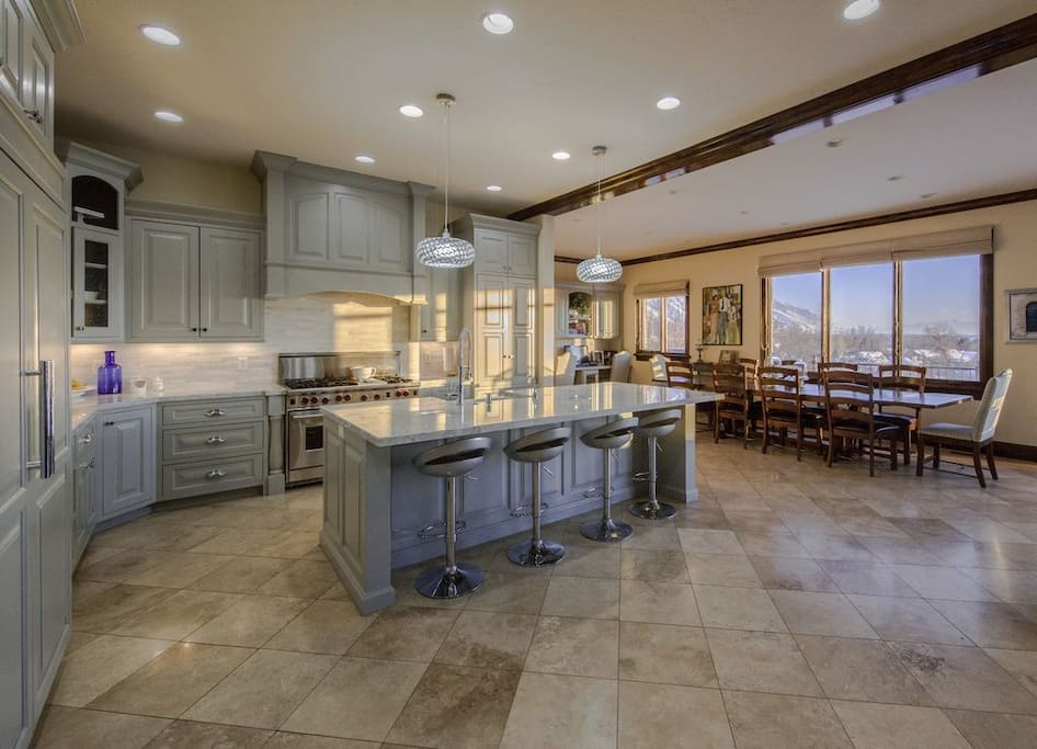 Large kitchen with marble counters