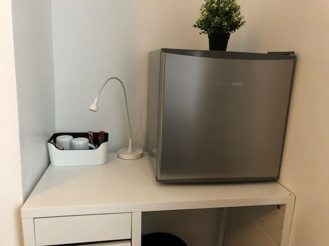 Desk, tea/coffee and fridge facilities in room