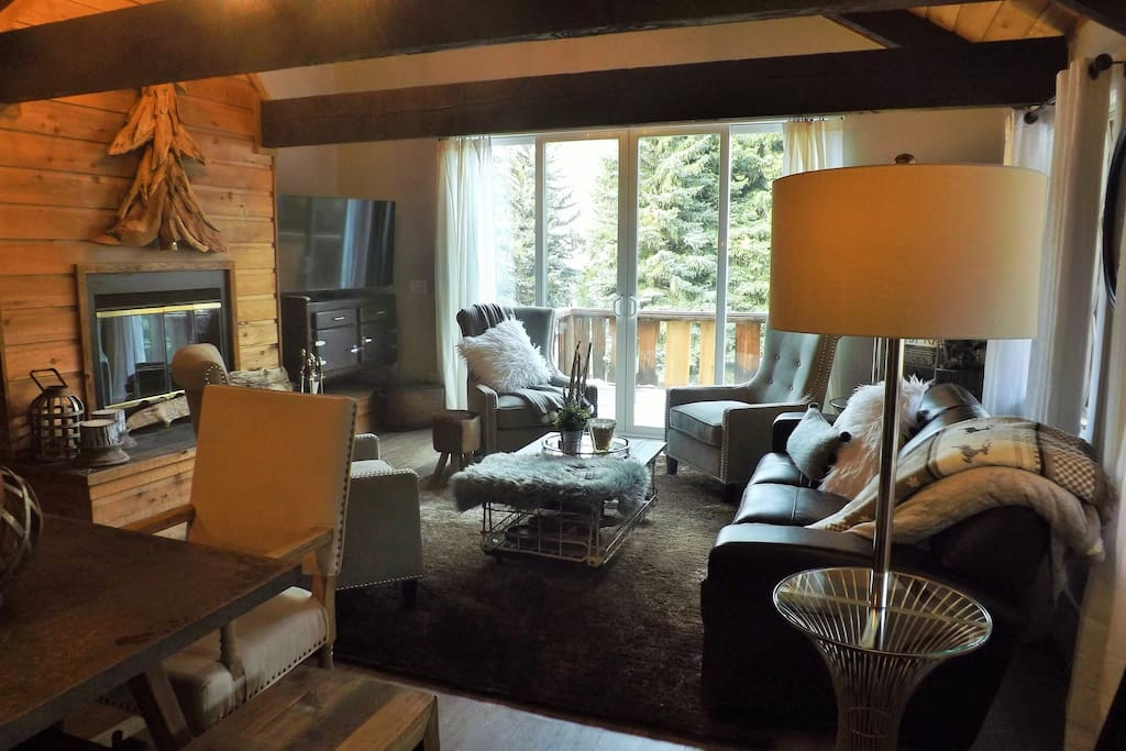 Relax in your cozy living room with crackling fire wood and your Gore Creek view