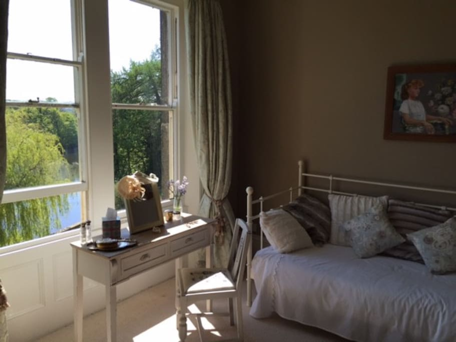 Crompton Suite. Spare single bed and river view