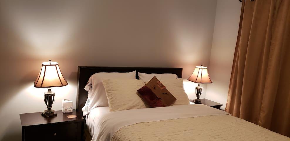 Cozy One Queen Bedroom Suite.