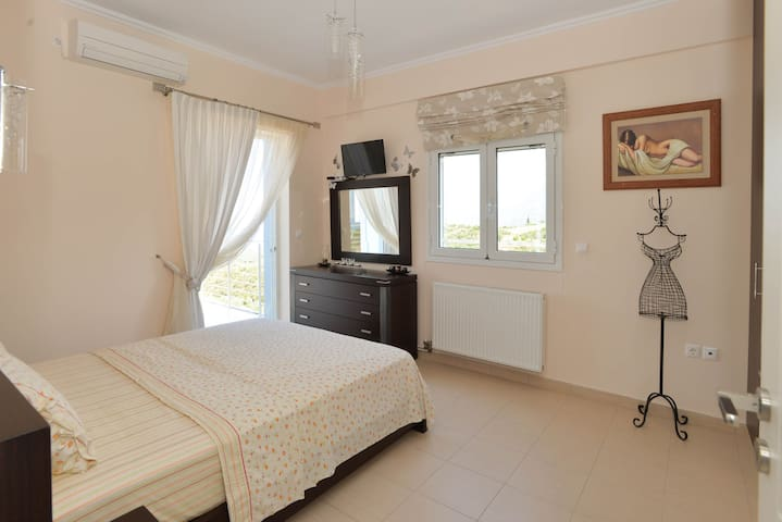 Main Bedroom with view over the Messinian Bay to the west and the city of Kalamata to the north