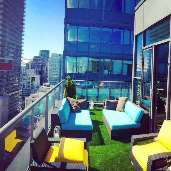Rooftop patio with artificial grass, wood deck, BBQ  (spring, summer and fall)