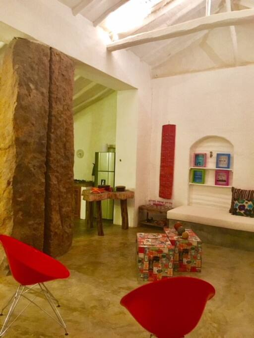 Living room with ancient stone pillar