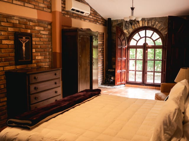 Main Bedroom with King Size Bed, Private Bathroom, A/C and plenty of bright natural sunlight