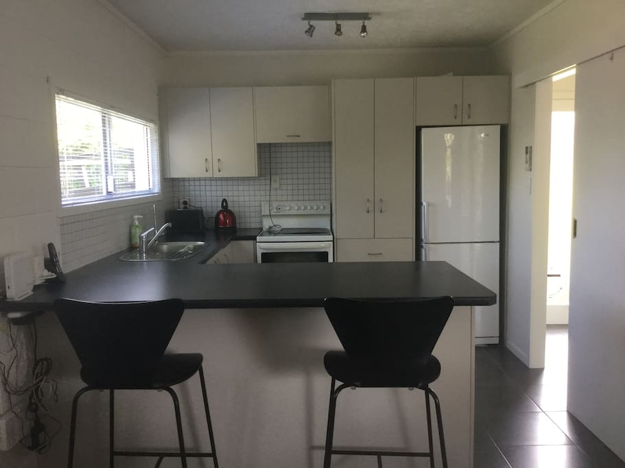 Fully equipt kitchen with dishwasher, oven, microwave, fridge/freezer, tea and coffee making facilities.