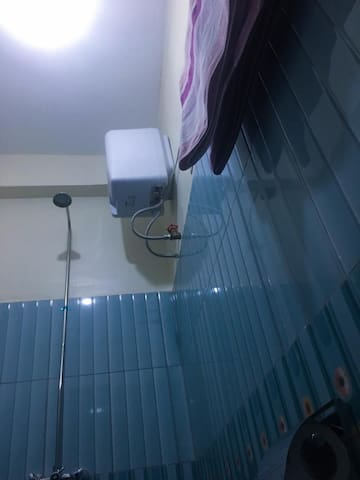 bathroom fitted with a water heater