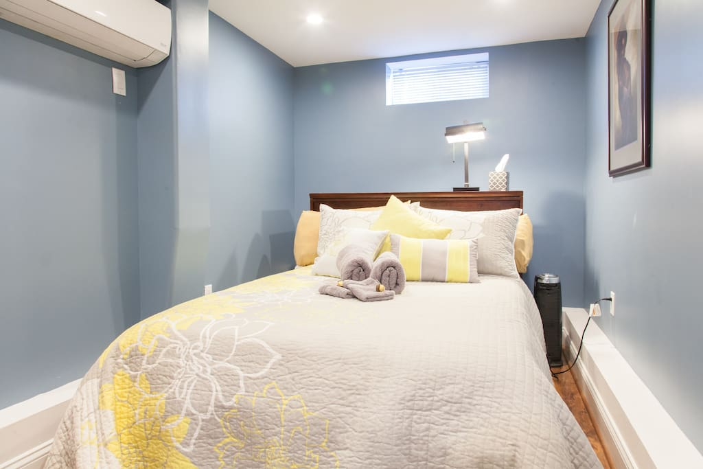Bedroom with built in A/C for our guests to control what  temperature setting is best for them.