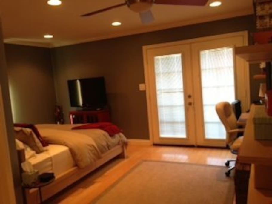 French Doors in master bedroom  leading out to back deck and backyard