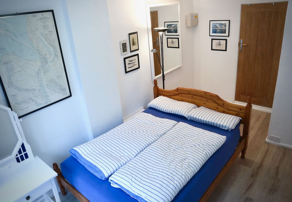 Downstairs - bedroom with double bed and dressing table