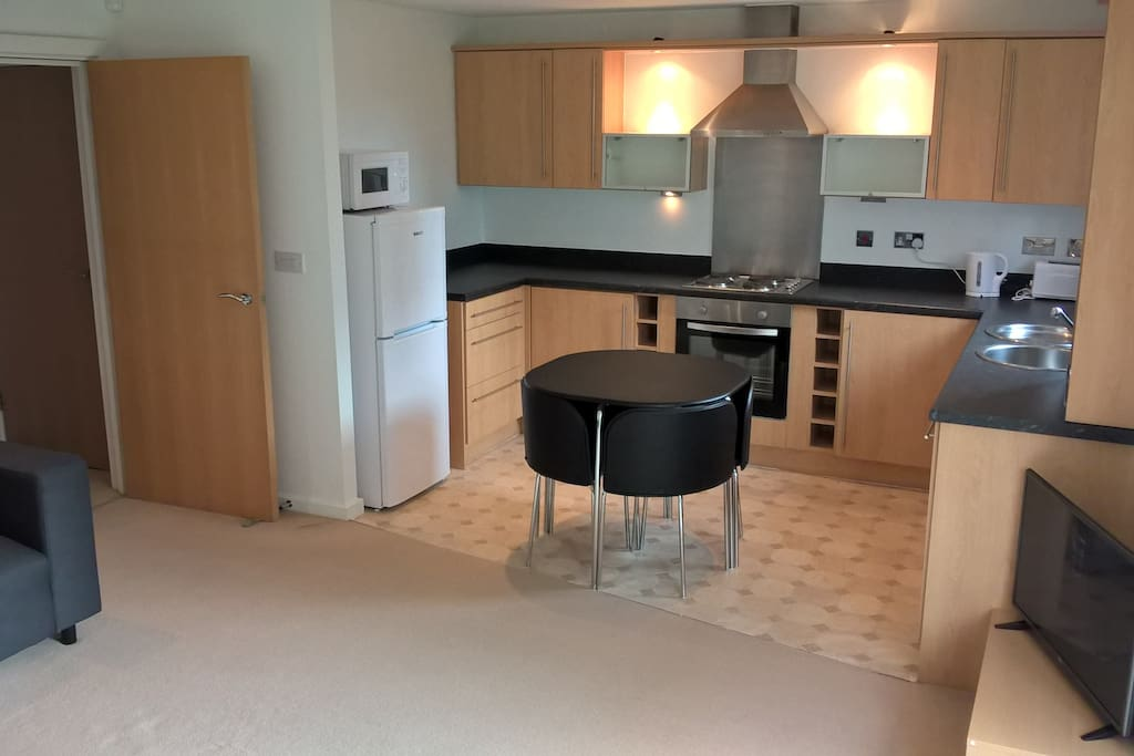 Fully equipped modern kitchen with dishwasher.