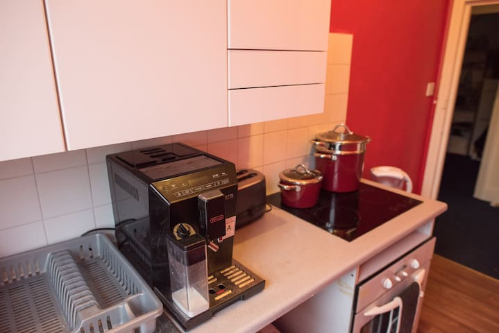 Coffee machine makes espresso, cappuccino and hot water for tea and hot chocolate