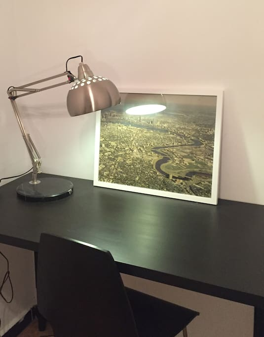 Desk for reading and working. The photo was Boston, a city we both love.