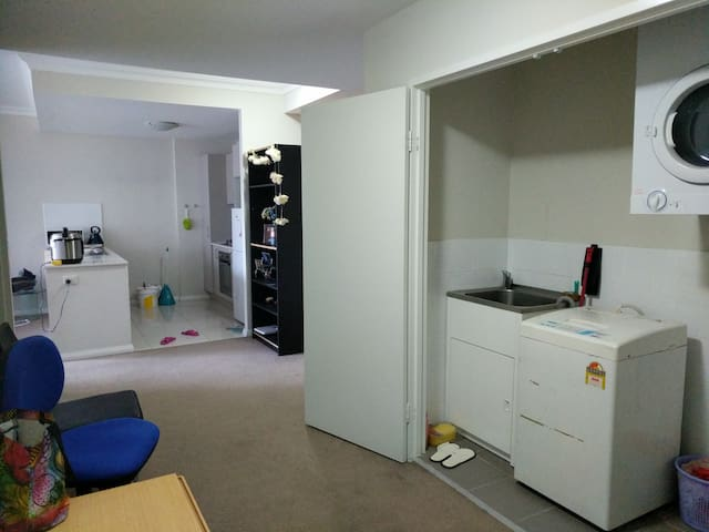 Laundry room through to kitchen